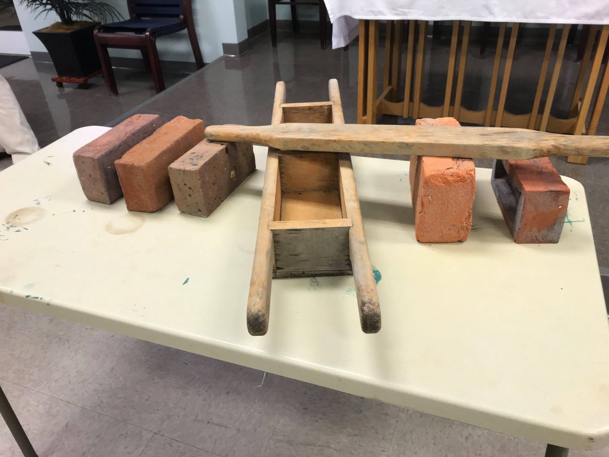 This wooden form, displayed at the recent DIHS meeting, is used to shape clay into bricks before they are fired.