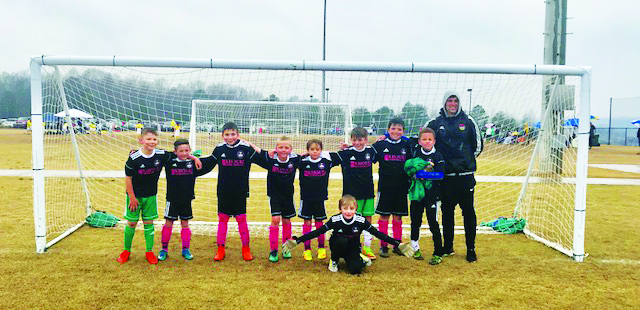 The DISA U10 Rangers placed first in their division at the Ray Thompsett Invitational. Front row, center: AJ Butterfield. Back row from left to right: Luke Balog, Sullivan Silbiger, Henley Mathews, Palmer Driggers, Arnold Ruiz, Kyle Thaxton, Hugh Mathews, Javier Clemons and Head Coach Justin Barlotta.