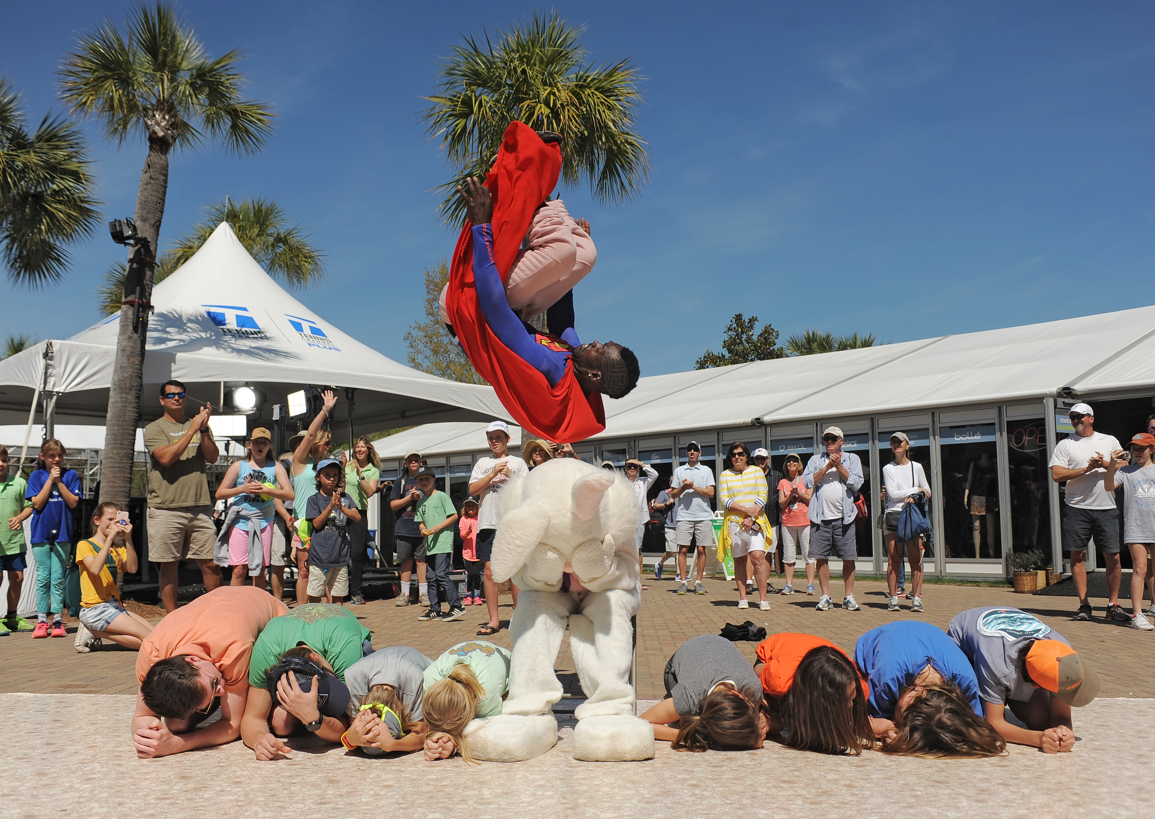 Kyle Kotic, aka Superman, flips over the Easter Bunny and members of the crowd for the finale of the strongman and break dance show the crew performed over Family Weekend at the VCO.