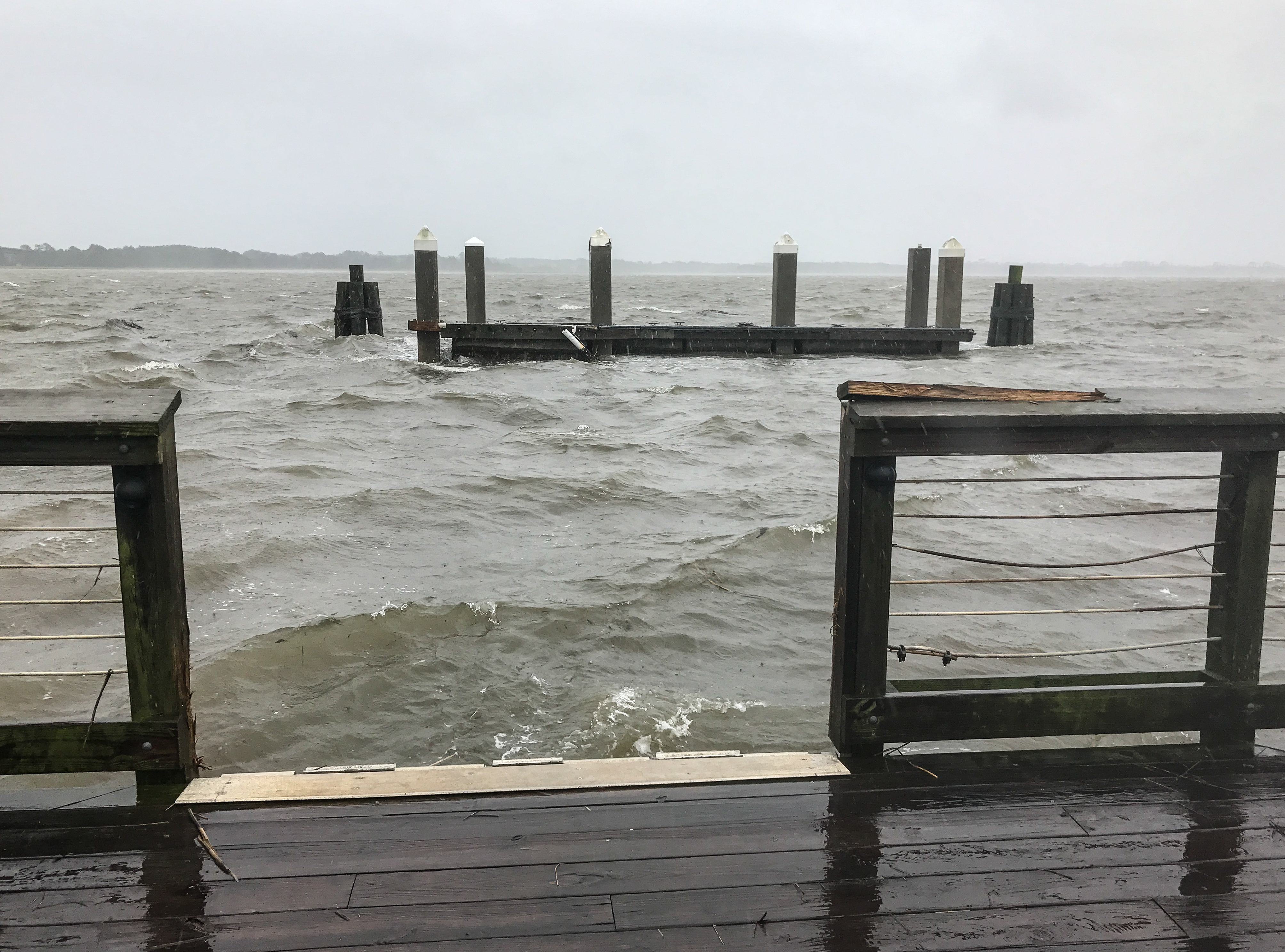 Mary Wessner Photography: Water claims portion of pier near the Children's Park dock.