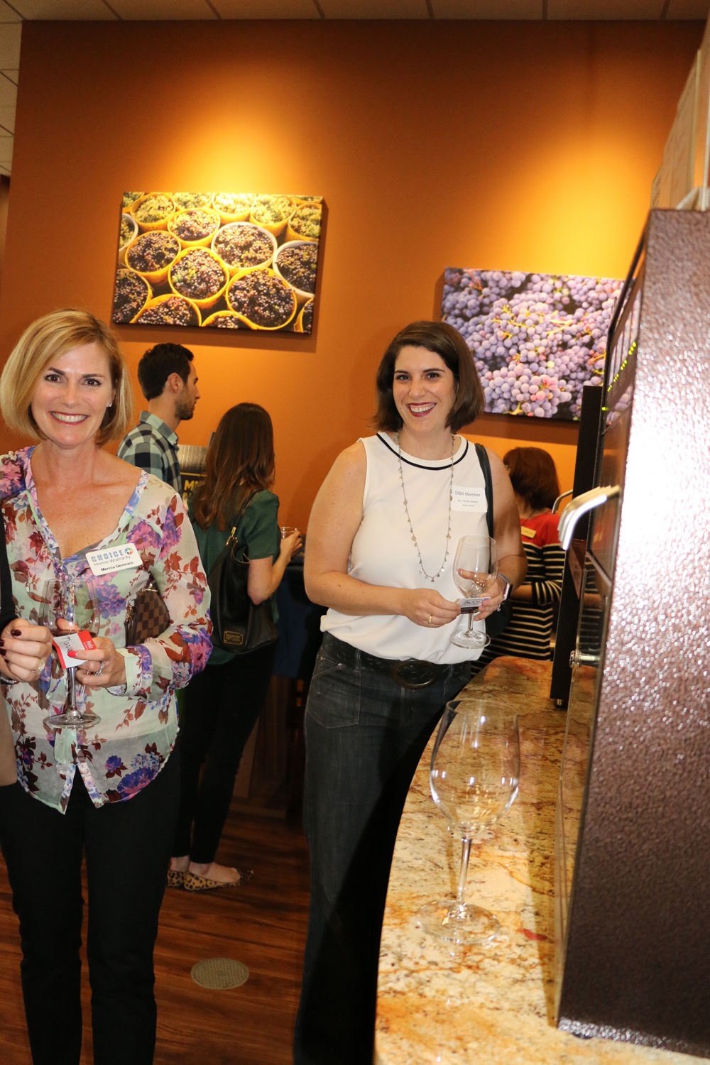 Marcia Germain and Nicole Stewart check out the Bin 526 wine bar selections.