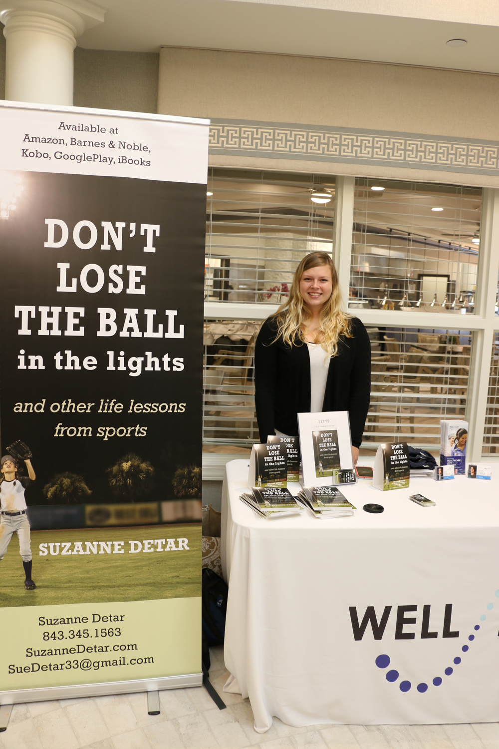 Daniel Island resident Cora Petyak sold multiple copies of Daniel Island News publisher Suzanne Detar's book, Don't Lose the Ball in the Lights and Other Life Lessons from Sports.