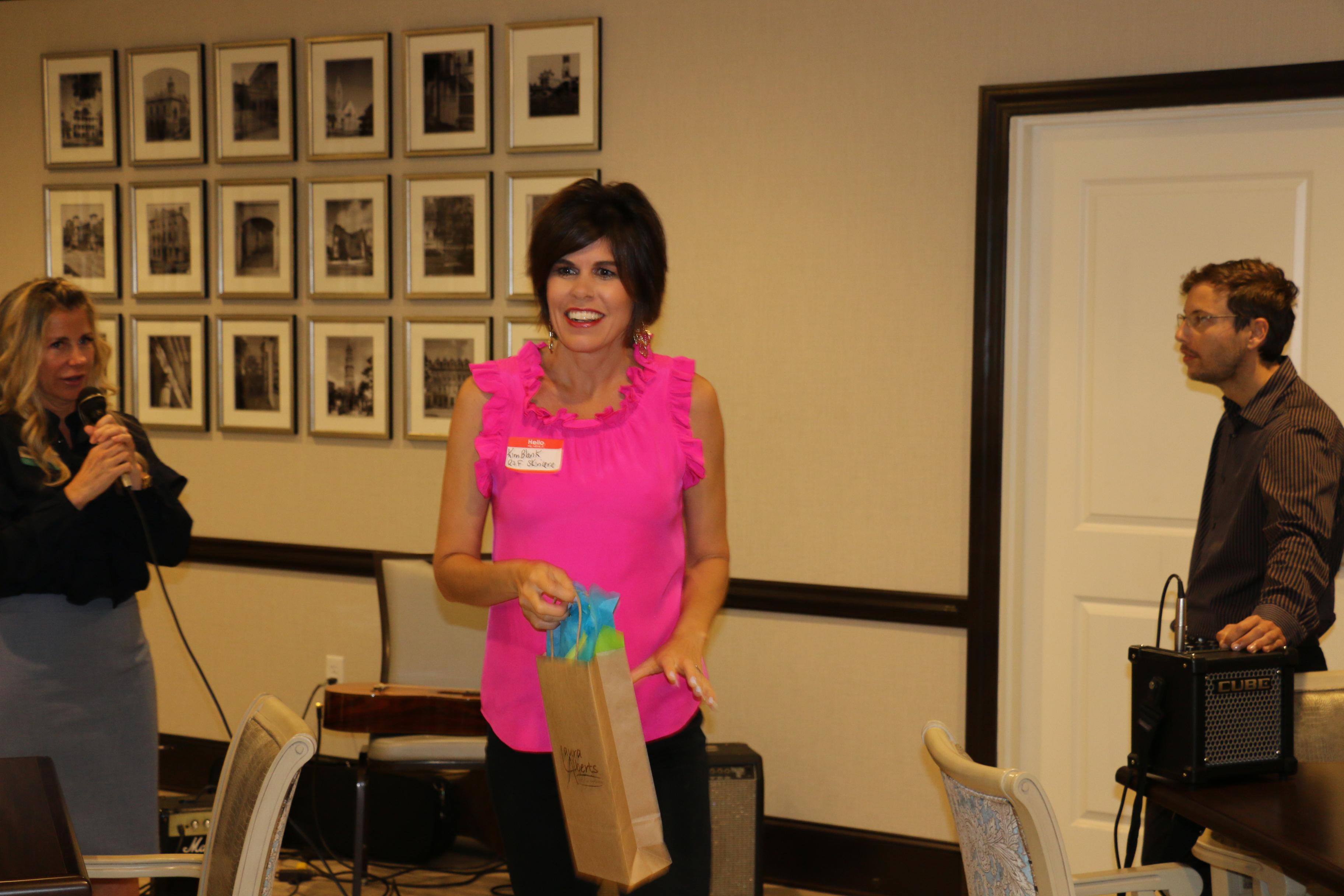 Kim Blank walks away with one of the sponsor prizes!