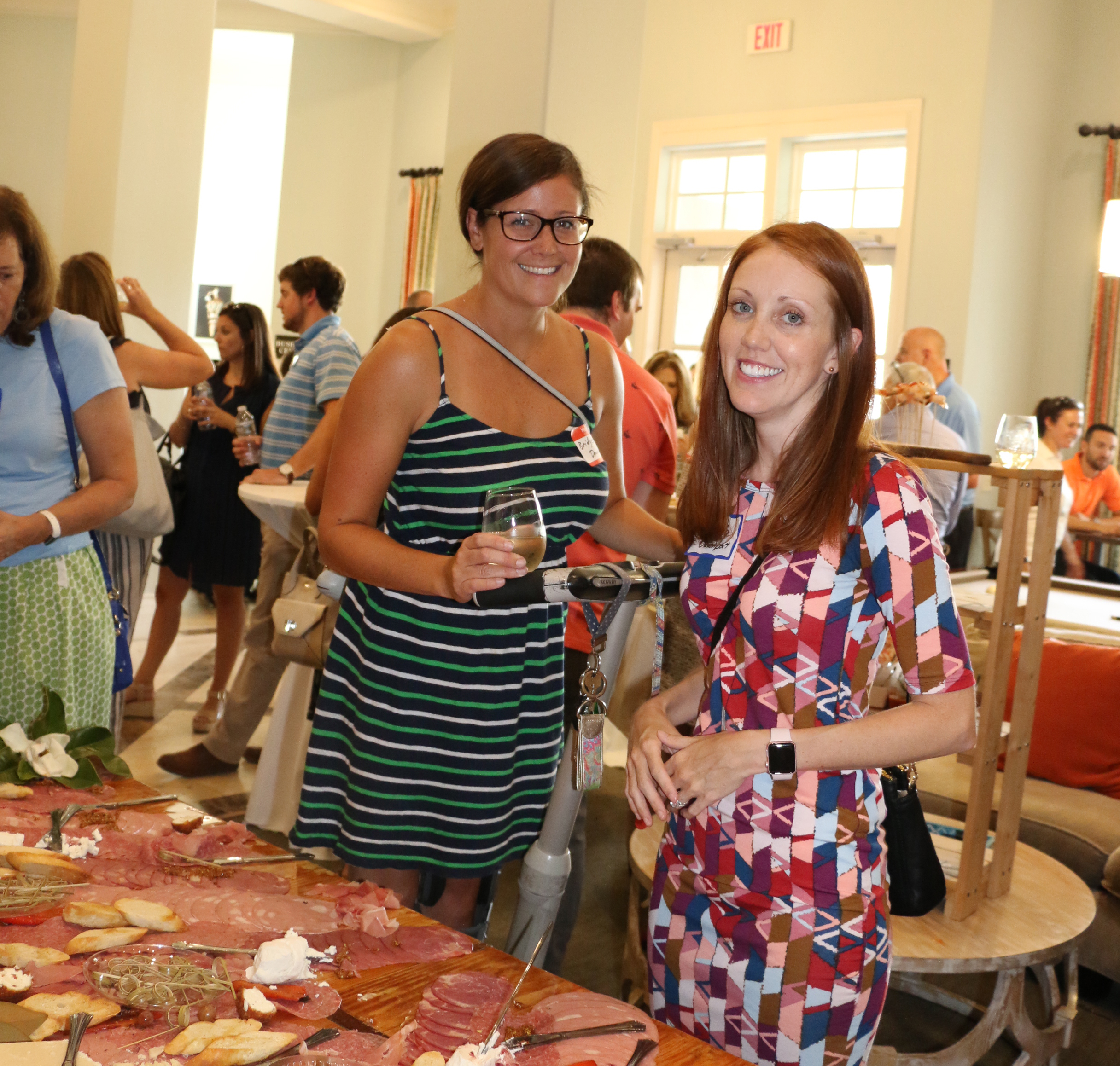 Bridget Downing and Amanda Davenport negotiate the food table inside!