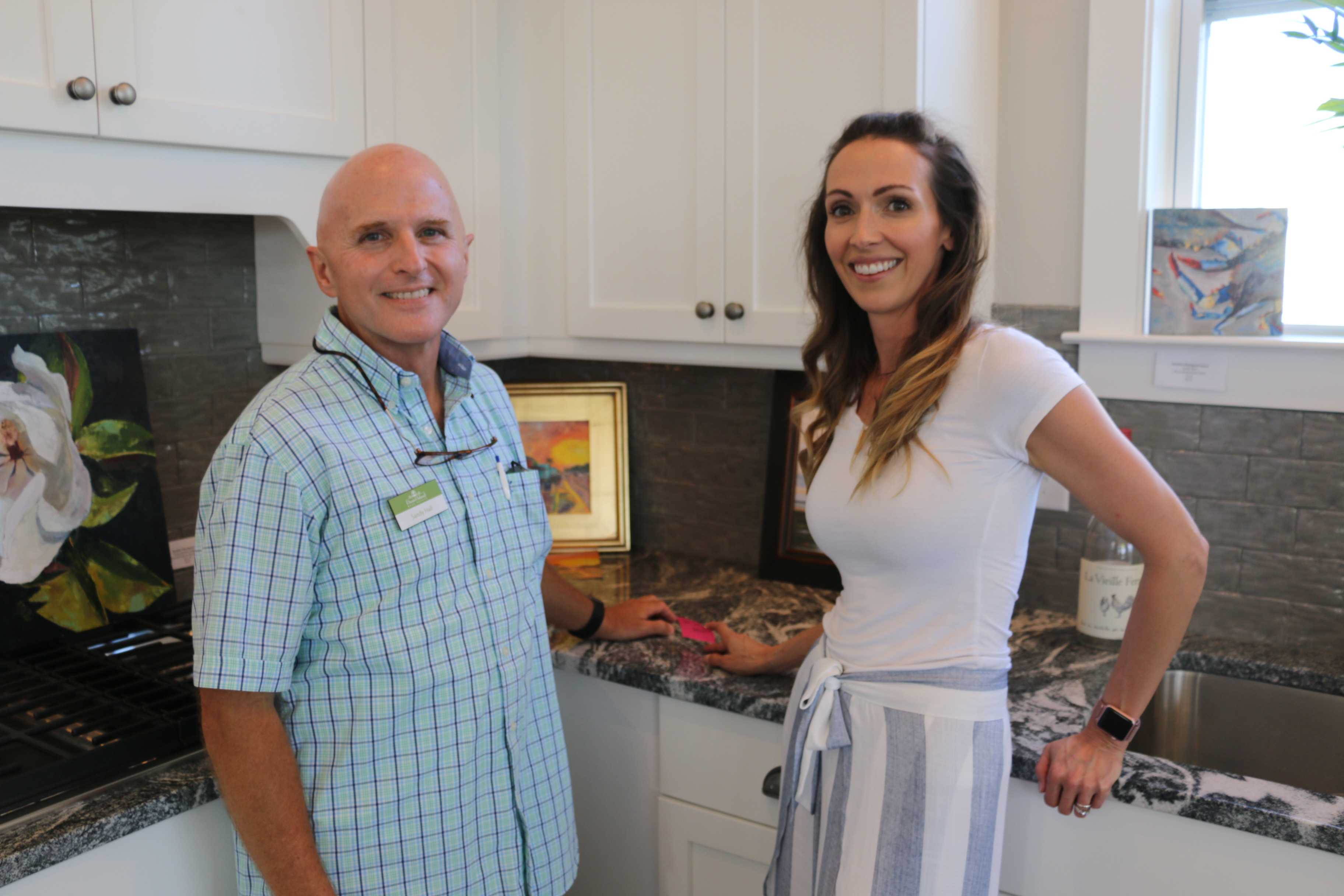 Sandy Hill of Daniel Island Real Estate (left) and artist Sara Shrouds (right).