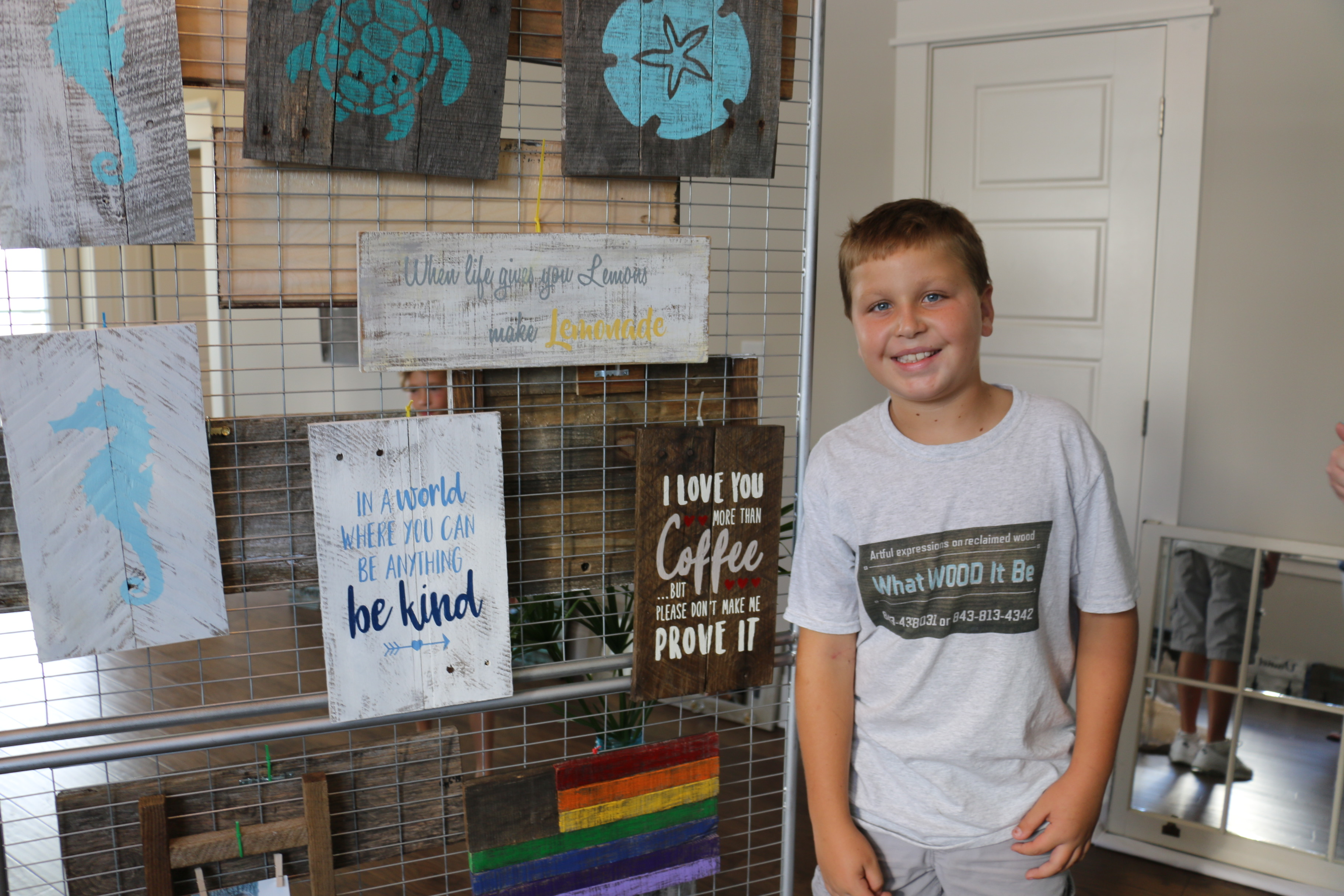 "Daniel Island resident Caden Scott was the youngest artist displaying work at the pop-up art shows. Caden's handmade ""What WOOD it be"" creations were a big hit among guests."