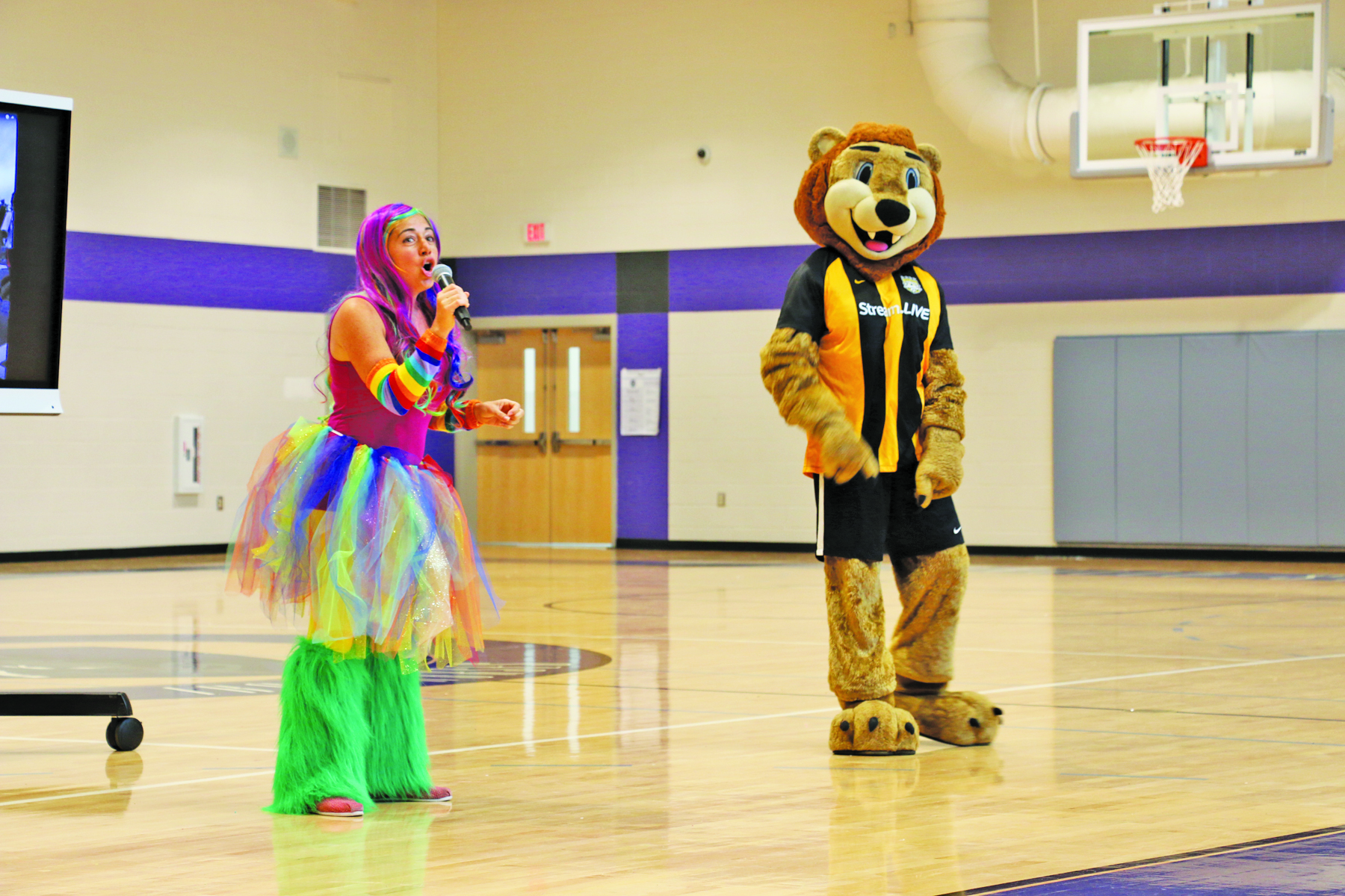 The Charleston Battery mascot gets the crowd pumped with help from parent volunteer Melyssa Jaskiewicz.
