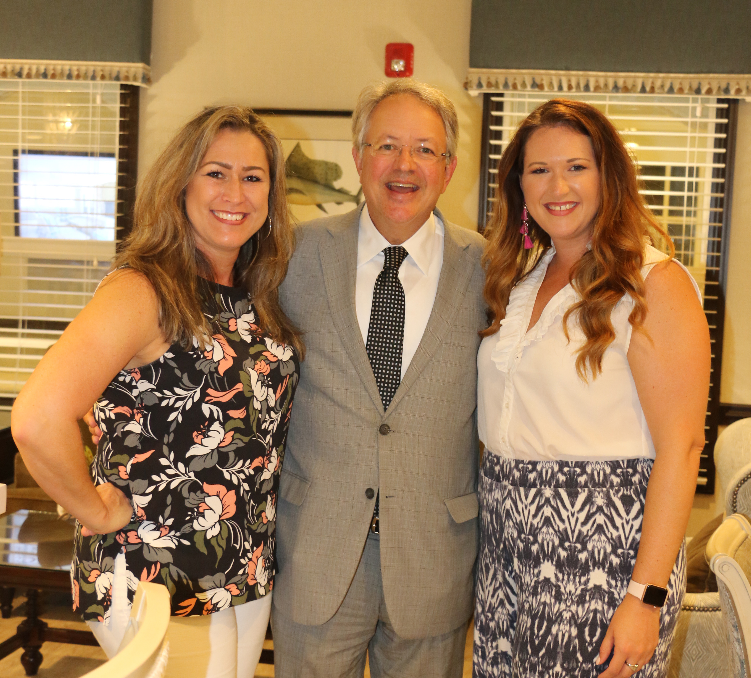 Heather Swan and Melanie Lawrimore pose with Charleston Mayor John Tecklenburg, who performed songs on the piano for the crowd.