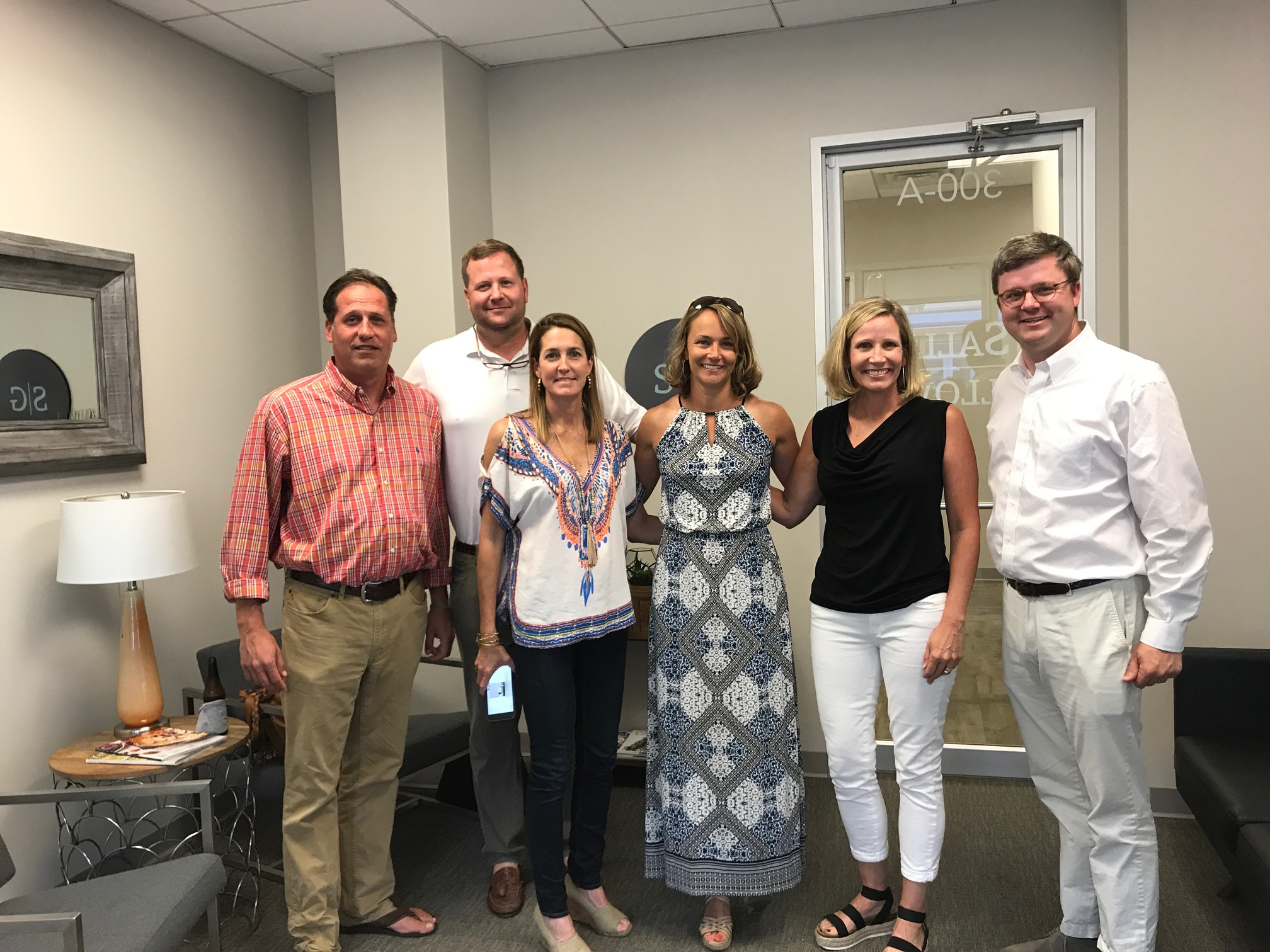Steve Demarco, Marshall Burns, Melissa Demarco, April Galloway, Laura Burns and Josh Whitley celebrate the grand opening of the Salle Galloway's Daniel Island location at 245 Seven Farms Drive, Suite 300. The practice also has a location in Greenville.