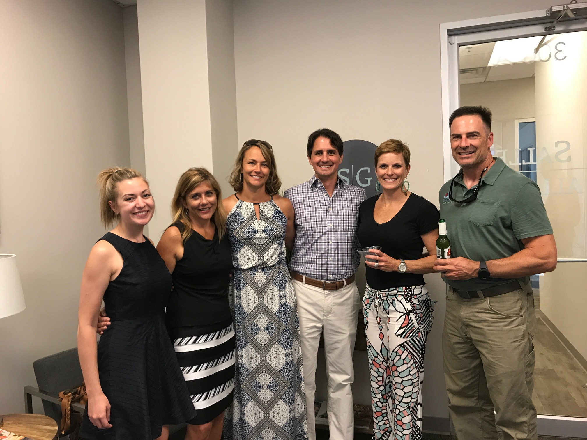 Emma Yocum, Beth Lee, April Galloway, Bret Galloway, Tracy Adams, Taylor Adams join in celebrating Salle Galloway's new Daniel Island office.