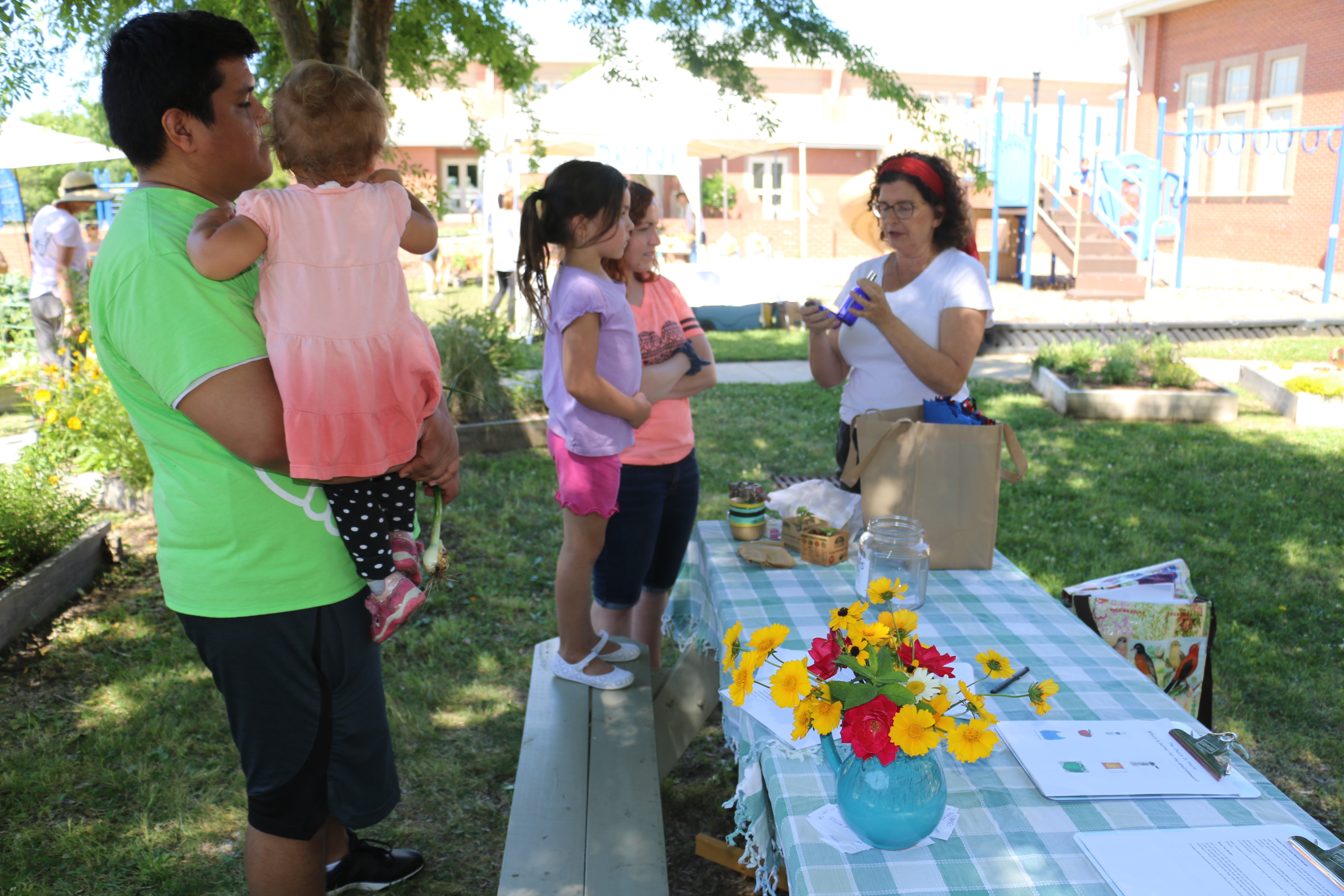 Volunteer Jacqueline Gowe demonstrates a craft for visitors to the garden.