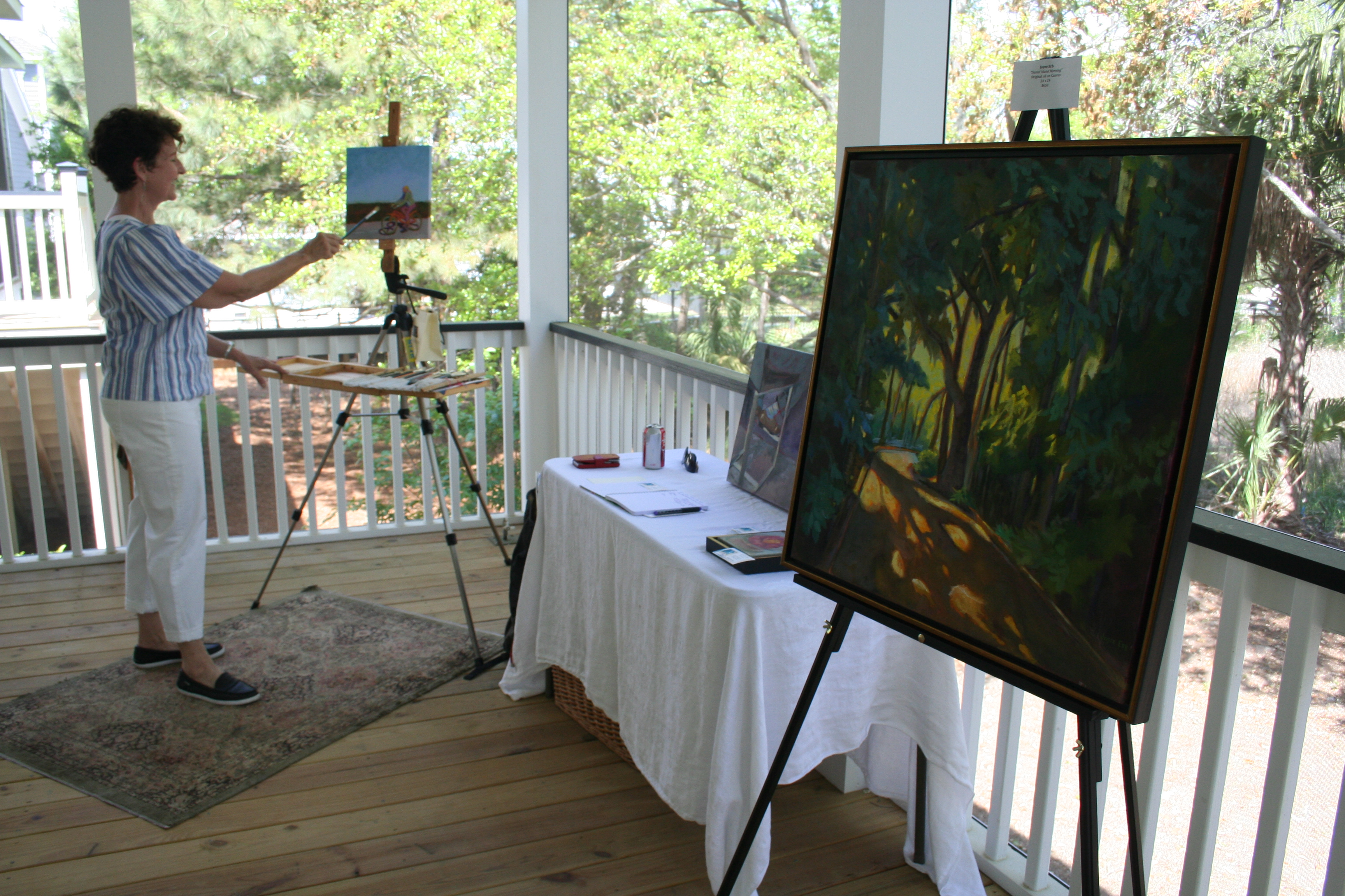 Scenes from the beautiful outdoors often serve as inspiration for artist Joyce Erb, who is shown here working on a piece on the back porch of the property.