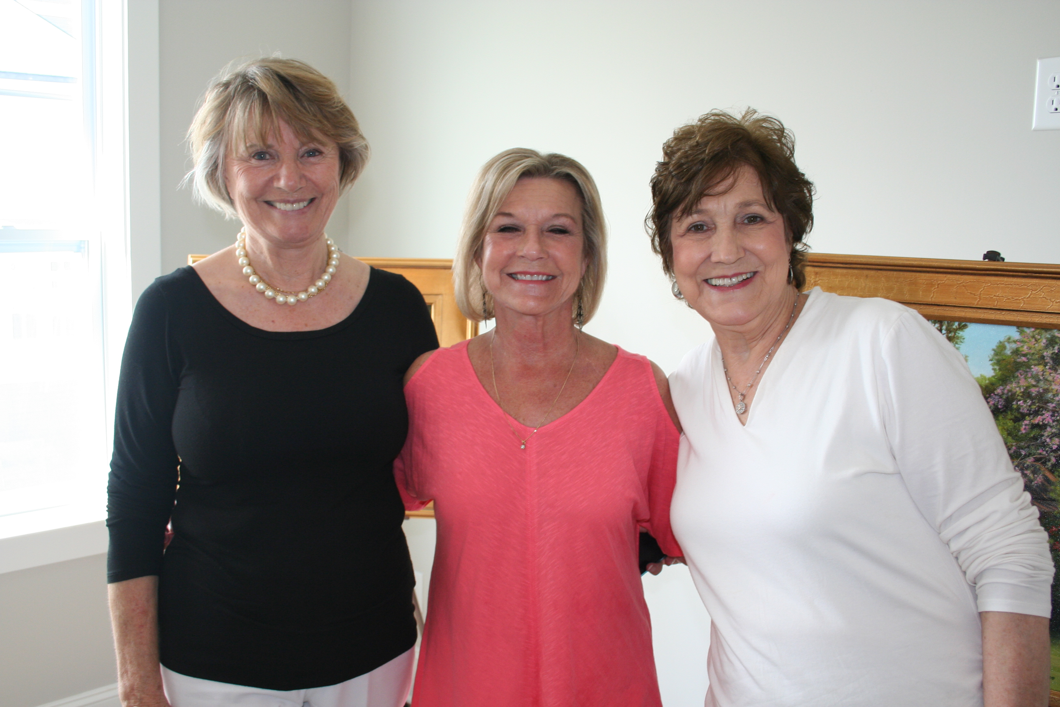 Artists Glenda Brown (left), Renee Magdelain (right), and Teresa Jones (center) all took part in the event by showcasing their works.
