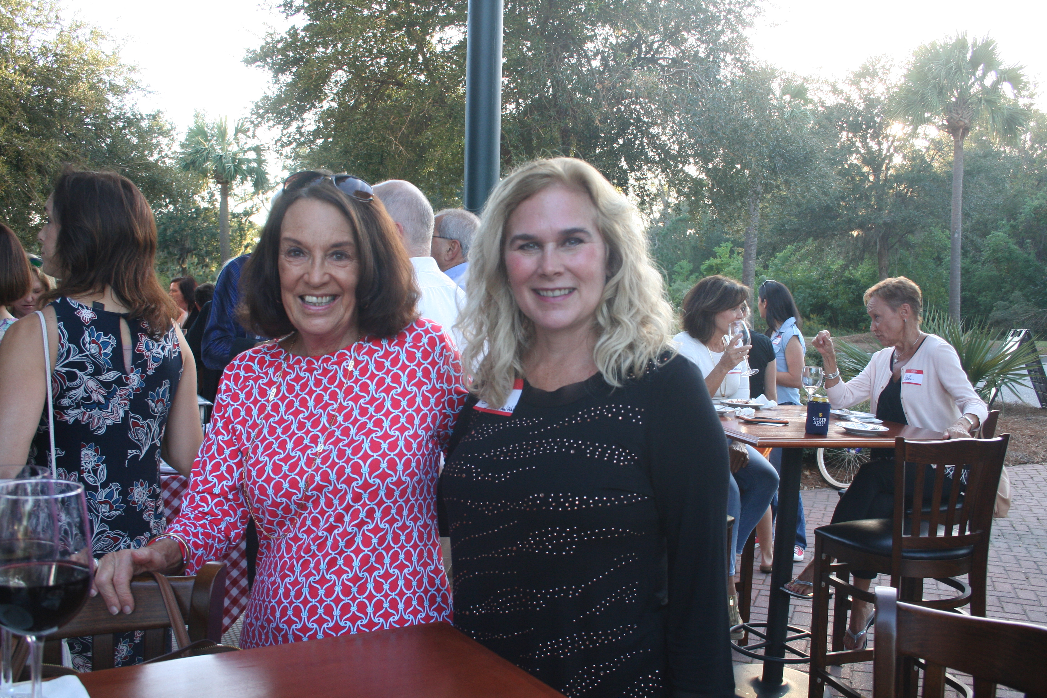 Nadine Hershey of Business Accounting Solutions and Sherri Seymour of CCGB Real Estate Group mingle with friends during the DIBA happy hour outside LIDI on a beautiful fall evening.