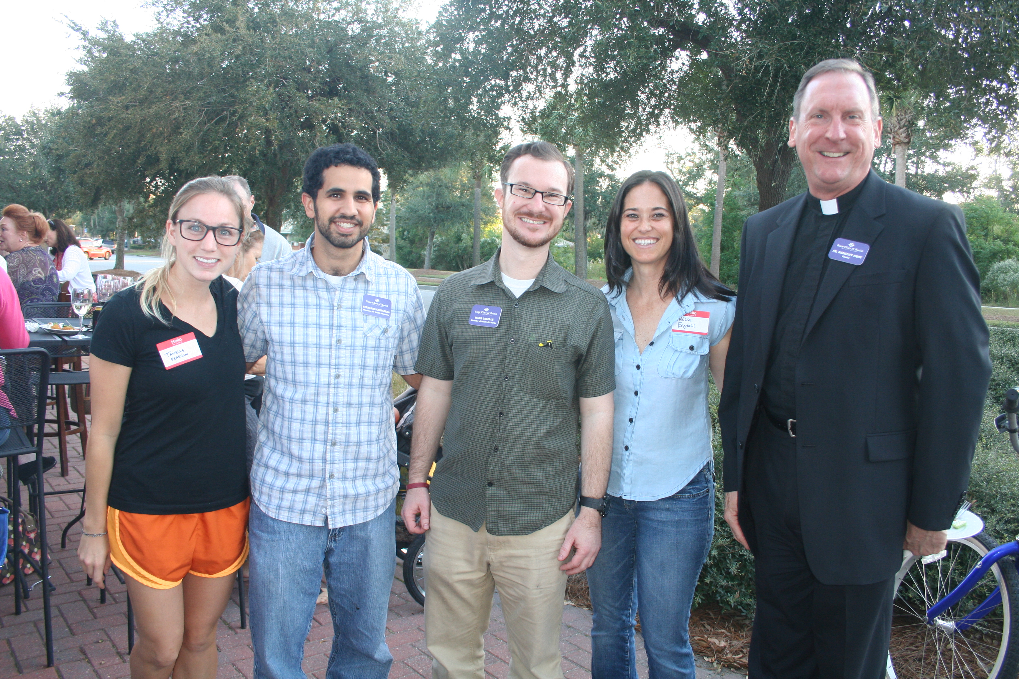 St. Clare of Assisi parish members and staff attended the Block Party. Pictured are member Tanelle Pearson, Director of Youth Ministry Fernando Cartagena, Director of Music and Liturgy Mark LaBelle, member Melissa Engdahl and Father Gregory West.