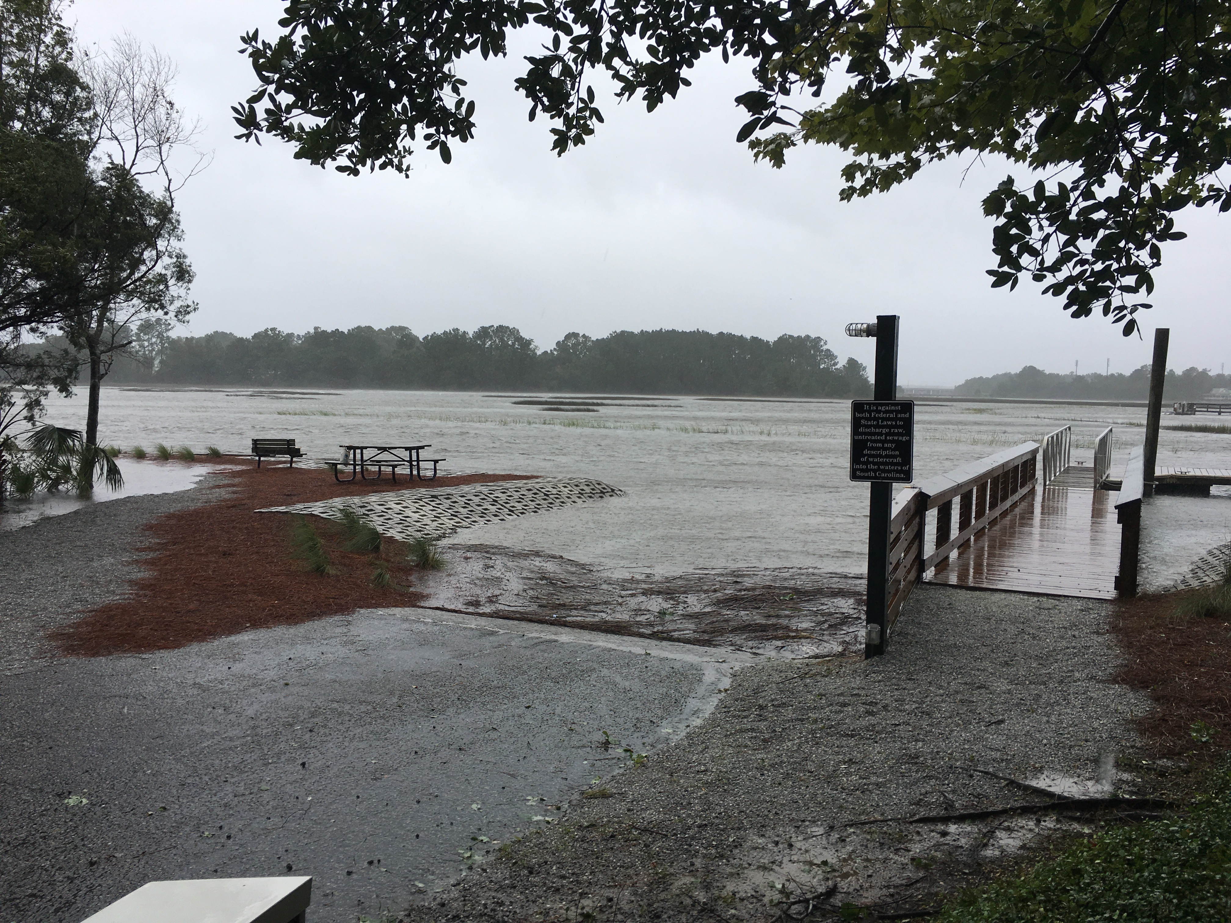Water spills out from Beresford Creek at the Bellinger Island boat landing.