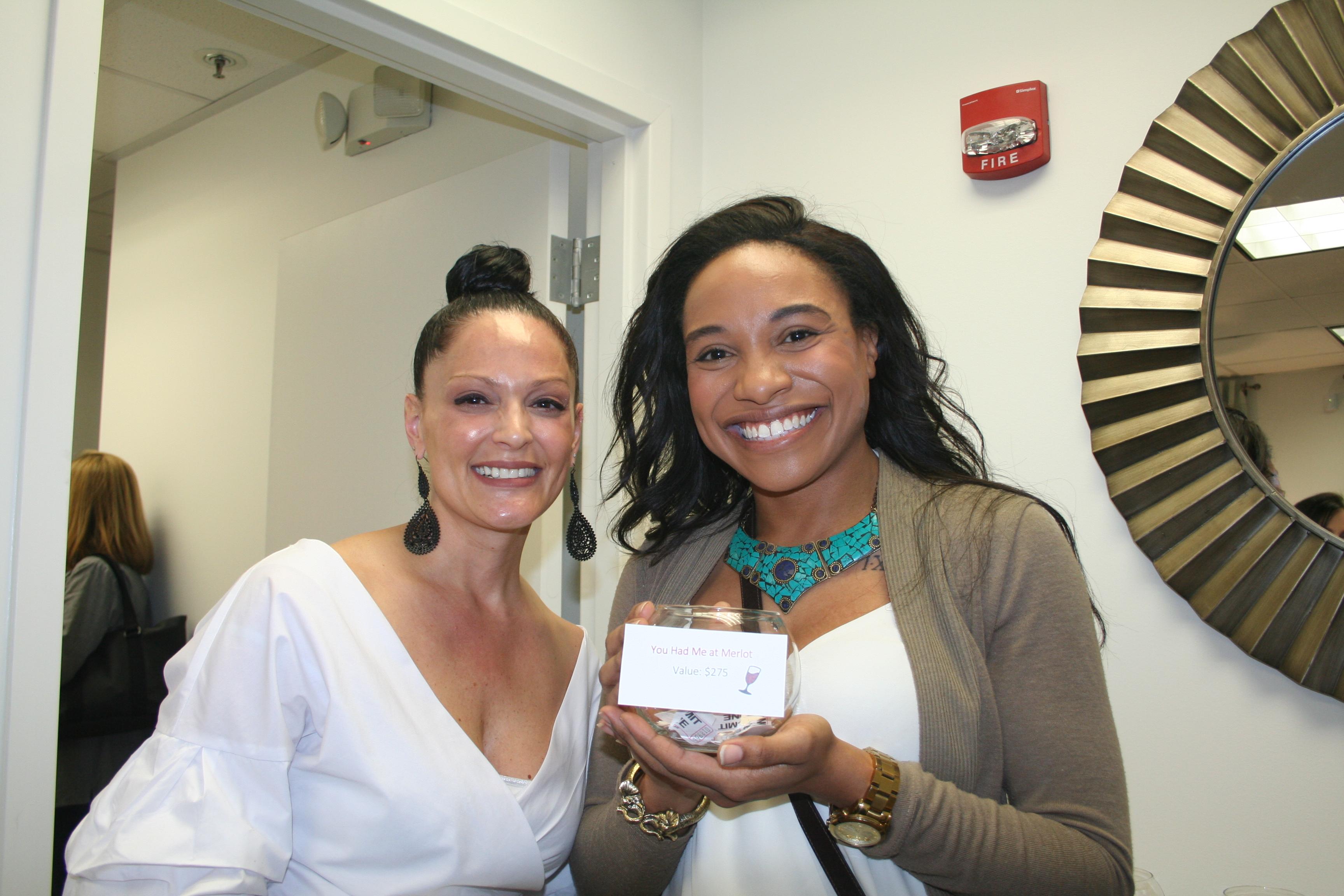 Esthetician Danielle Cios and raffle winner Yolanda Williams.