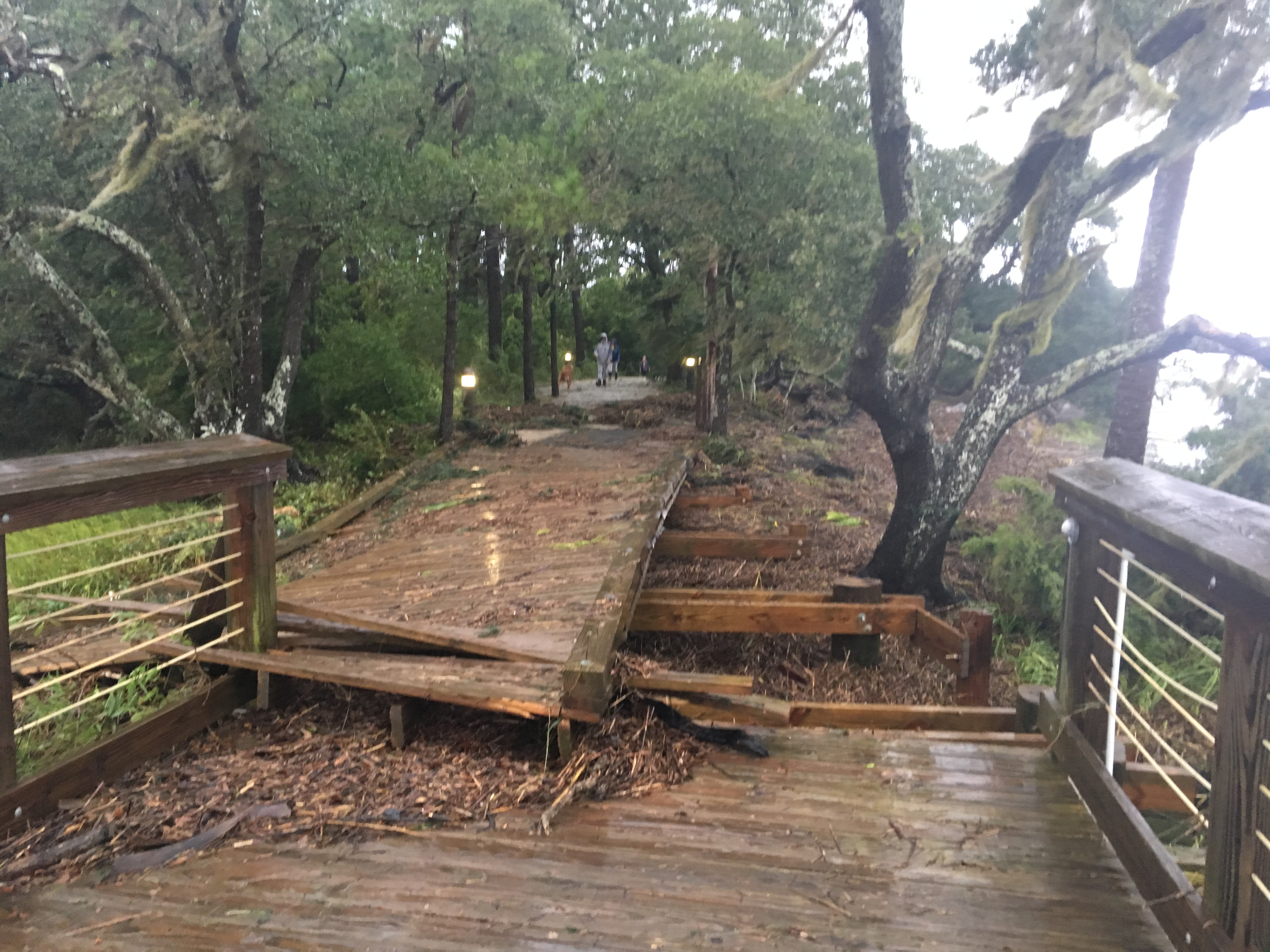 A portion of the boardwalk along the trail near Children's Park is destroyed by a raging tidal surge.