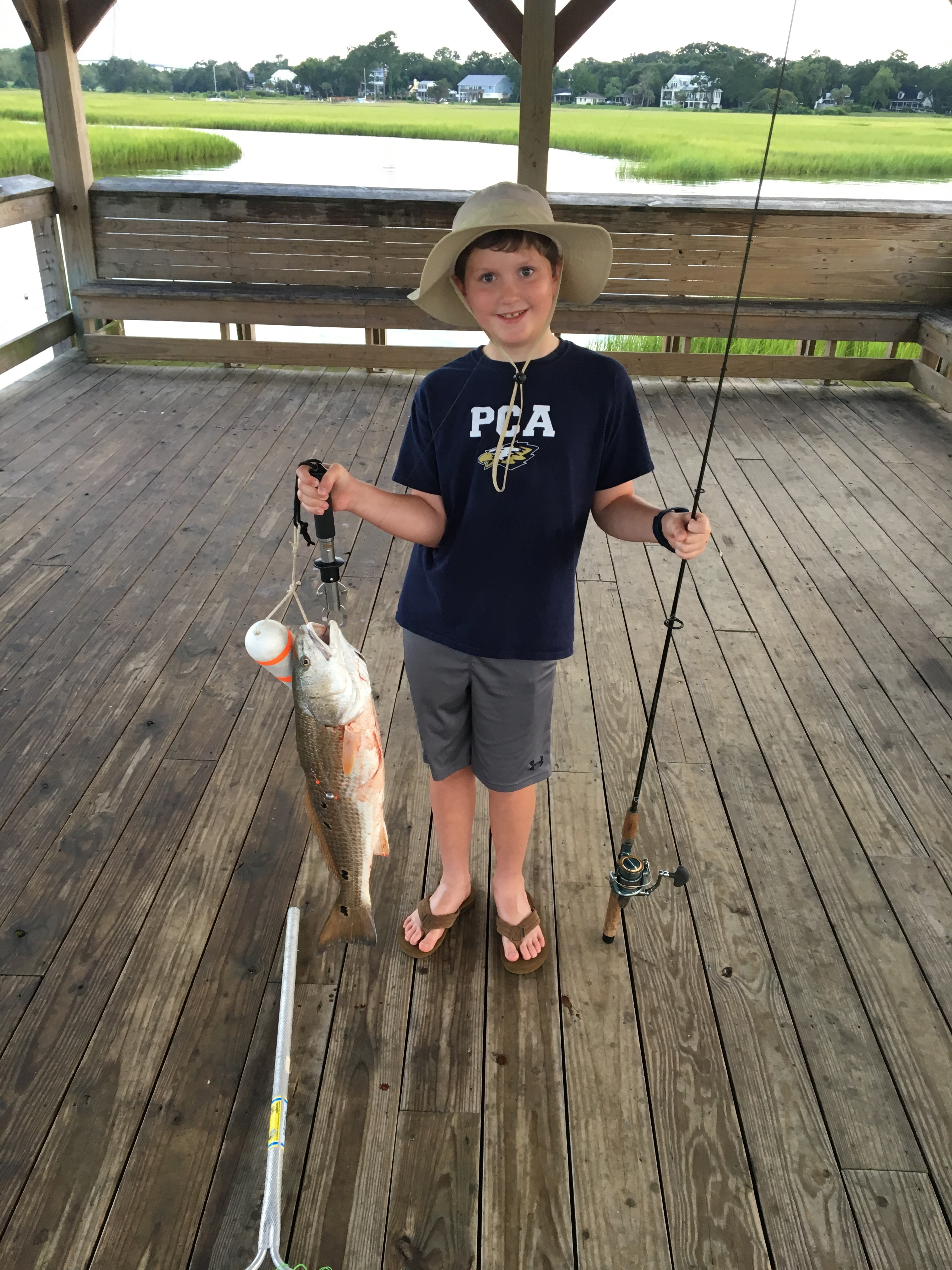 ongratulations to Daniel Island resident Charlie Angerman, who recently caught and released his first big fish! Charlie hooked the 27-inch big red drum on August 9 on the Shem Creek Pier with his Poppy, Hugh Tant.