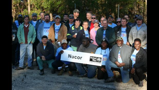 Taking part in the Nov. 17 Day of Caring effort in Huger were more than 100 volunteers, the majority of them employees from nearby Nucor Steel. Hearts of Huger, a local 501c3 organization with a mission to uplift and revitalize the Huger and Cainhoy communities, was front and center, keeping things running smoothly.