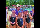City Meet 7-8 girls free relay champions Willa LeVeen, Sarah Ligon, Charlotte Good and Lilah May pose with Flying Fish head coach Rose Van Metre.